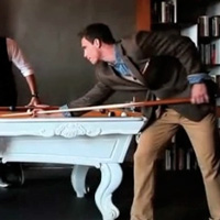 Male JCPenney clothes models playing pool